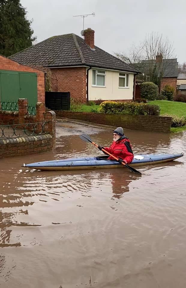 Hereford Times: Navigating Brampton Road, Madley, in a canoe. Photo: John Dinnen