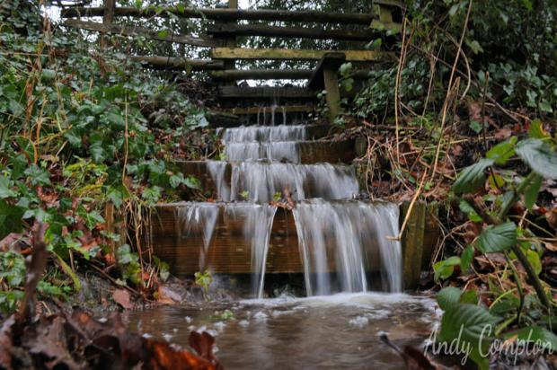 Hereford Times: A footpath turns into a waterfall near Kington. Photo: Andy Compton