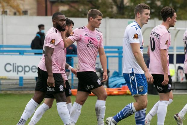 Hereford Times: Hereford celebrate after Lenell John-Lewis scored the winning penalty. Picture: Andy Walkden/Hereford FC