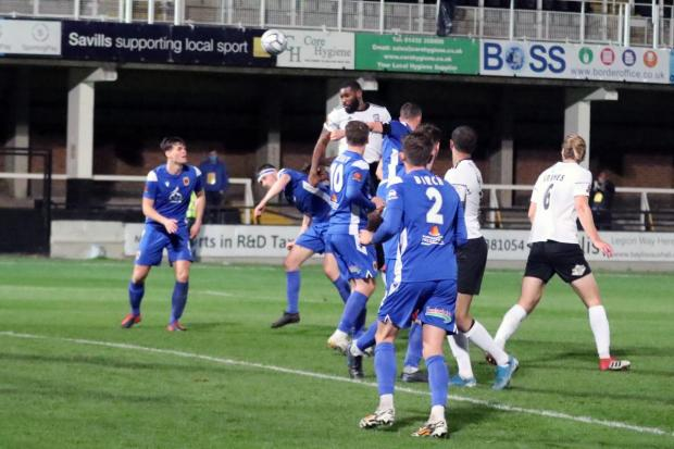 Hereford Times: Lenell John-Lewis heads home the equaliser. Picture: Steve Niblett/Hereford FC