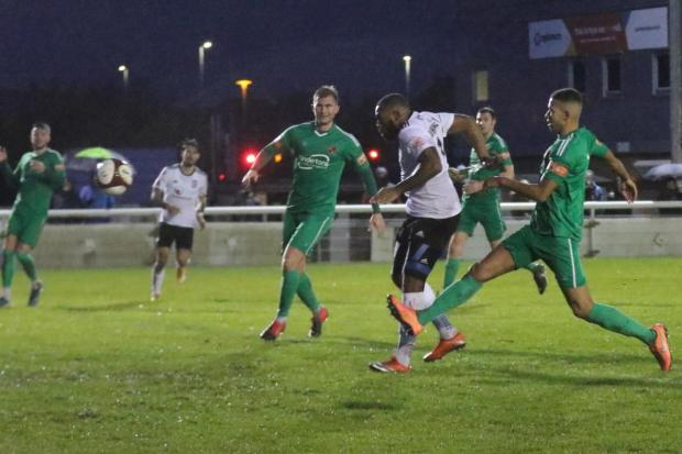 Hereford Times: Lenell John-Lewis scores the winner. Picture: Steve Niblett/Hereford FC