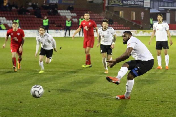 Hereford Times: Lenell John-Lewis fires home from the penalty spot. Picture: Steve Niblett