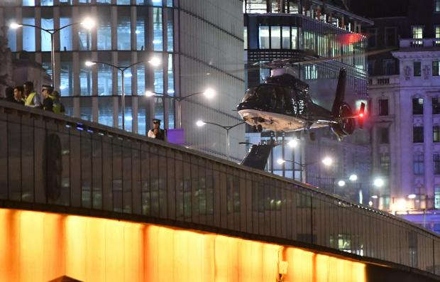 Hereford Times: One of the SAS helicopters landed on London Bridge during the 2017 terror attack. Picture: PA Wire
