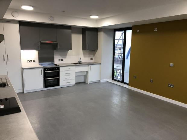 Hereford Times: A completed kitchen inside the new student accommodation in Station Approach, Hereford