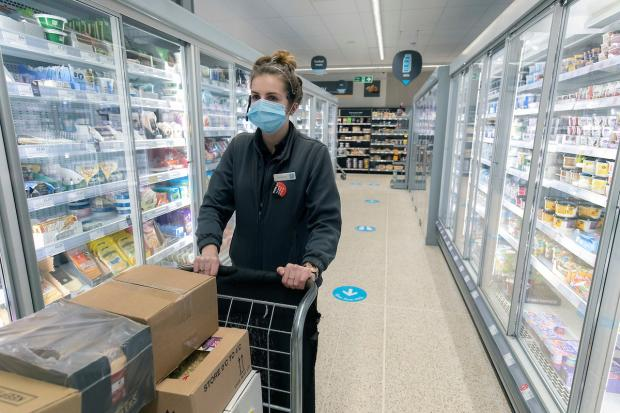 Hereford Times: Store manager at Co-op in Crabtree Road, Kington, at the official relaunch