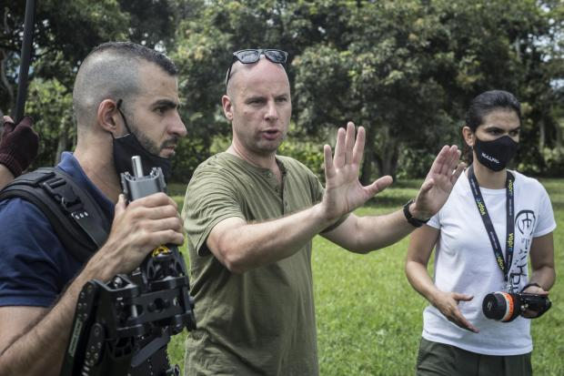 Hereford Times: David Whitney, centre, on set in Colombia