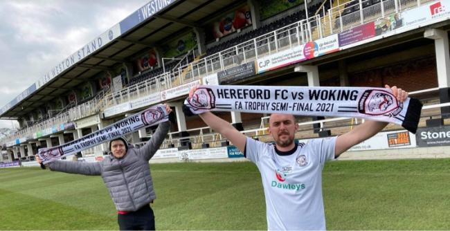 Club volunteers, Lee Mills (left) and Don Cooke show their support ahead of Saturday's semi-final game against Woking.The Bulls will play National League side Woking in the FA Trophy semi-final at Edgar Street this coming Saturday.