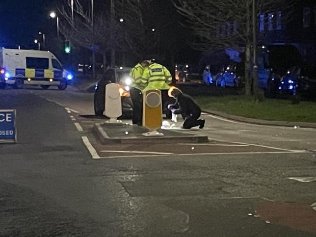 Hereford Times: Two police officers and forensics at the scene on Saturday evening