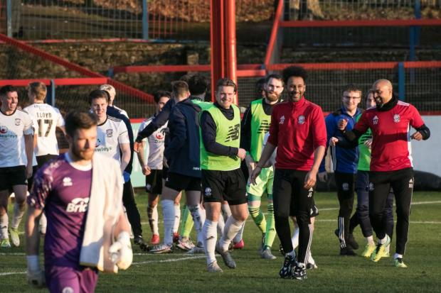 Hereford Times: Hereford celebrate their win at Aldershot. Picture: Andy Walkden/Hereford FC
