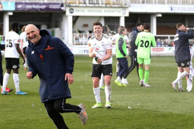Hereford Times: Goal scorer Joey Butlin celebrates Hereford semi-final win. Picture: Steve Niblett/Hereford FC