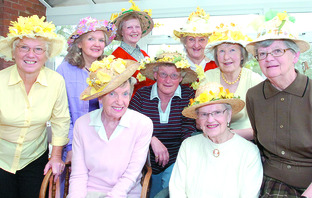 Taking part in Holmer WI's Easter bonnet competition are Maureen Graver, left, Norma Smith, Barba