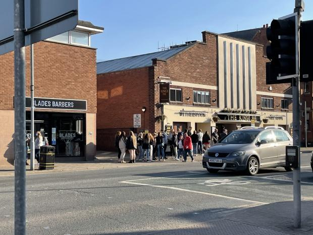 Hereford Times: The queue outside JD Wetherspoon's The Kings Fee, Commercial Road, on Saturday afternoon