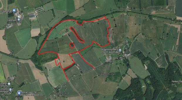 Hereford Times: Plans have revealed some of the details of a proposed new solar farm in Westhide, near Hereford. The proposed site is outlined in red. Picture: Google
