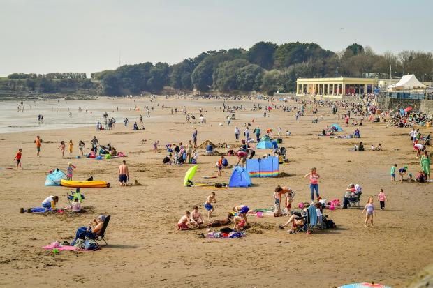 Hereford Times: People flocked to Barry Island in March when the temperatures started to rise. Picture: PA Wire