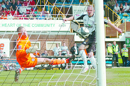 Ryan Valentine follows up to score Hereford United's second and decisive goal in the 2-1 win over Rochdale after visiting keeper Frank Fielding had saved his penalty.