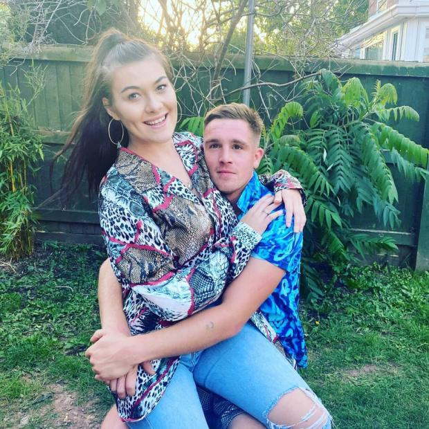 Hereford Times: Daniel Turner, pictured with his partner Elishia Paxton, survived after 'dropping dead' for 17 minutes in front of his kids. Picture: SWNS