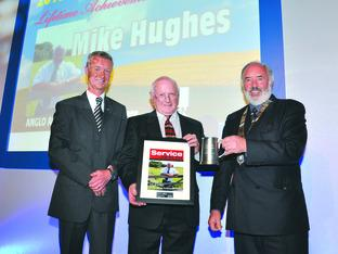 Mike Hughes (centre) with award sponsor Anders Hildebrand and current BAGMA president Howard Pullen.