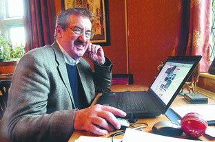 Actor John Challis checks out the news at herefordtimes.com on his new laptop.