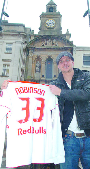 A Red Bull in Hereford - Carl Robinson shows off his New York Red Bulls shirt in front of the Buttermarket in High Town. 1101210-1 Picture by DAVID GRIFFITHS