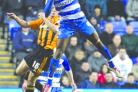 Mathieu Manset wins an aerial duel for his new club Reading against Hull City.