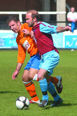 Mark Hibbard (right) holds off a challenge from Wellington's Wayne McNeil.