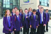 Year seven pupils arriving at the brand new Hereford Academy school building on their first day of term.