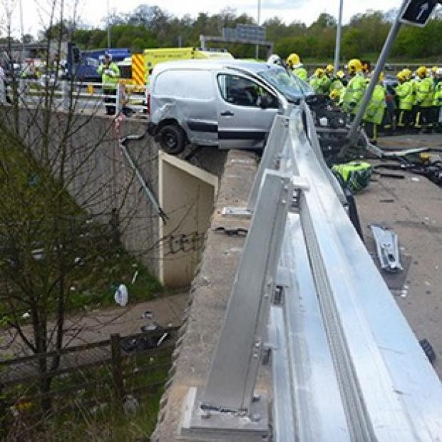 A van hanging off the M60 motorway in Stockport following a traffic accident
