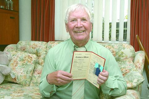 Graham Davies with his army records