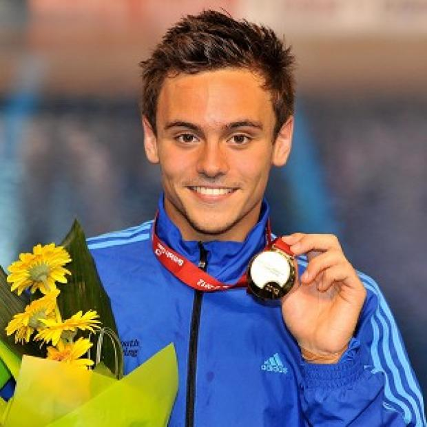 Tom Daley with his gold medal after winning the Mens 10m final