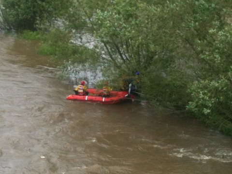 Firefighters rescuing three stranded children from the River Wye