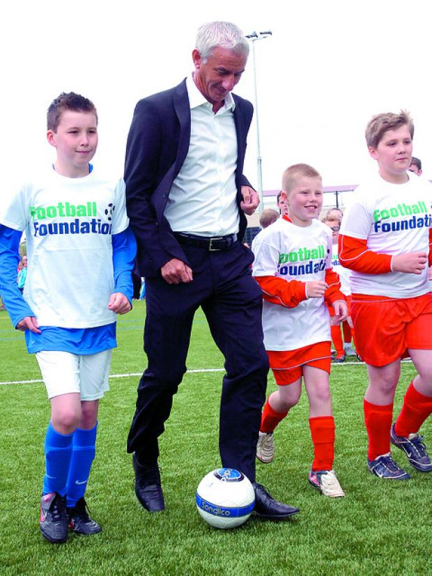 Ian Rush shows off his skills to (from left) Lewis McBride, Joshua Stilwell and Jordan Hawes.