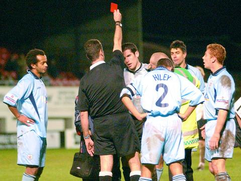 Referee Robert Desmond brandishes the red card at Edgar Street on Boxing Day 2003 at then Exeter goalkeeper James Bittner, who has now joined the Bulls.