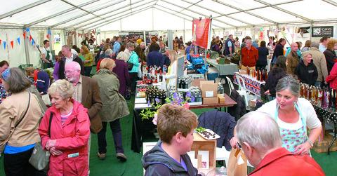 Visitors enjoy browsing in one of the food marquees.