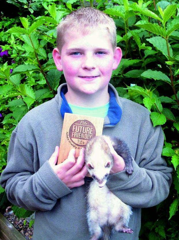Ten-year-old Jack with one of his ferrets