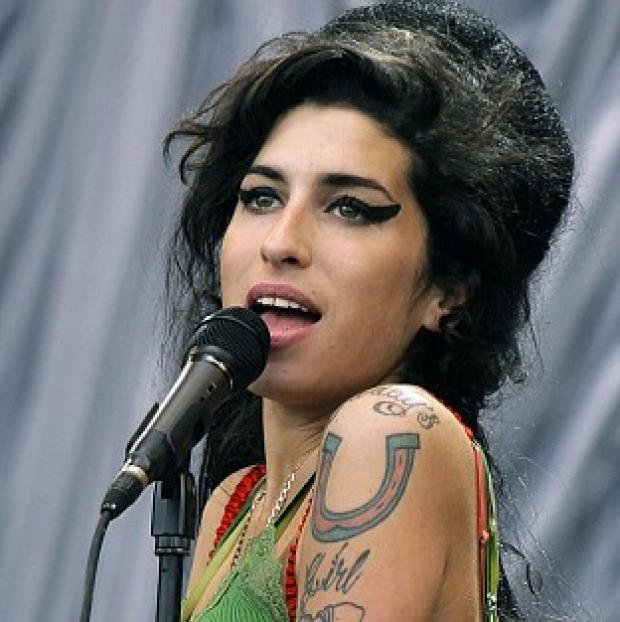Amy Winehouse's album Back To Black rocketed back to the top of the Official Albums Chart a week after she died