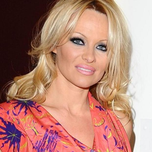 Pamela Anderson won't let men be a distraction as she competes on DWTS for a second time