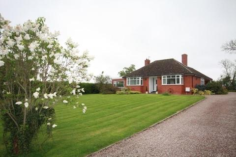 Property surrounded by extensive gardens in Sutton St Nicholas