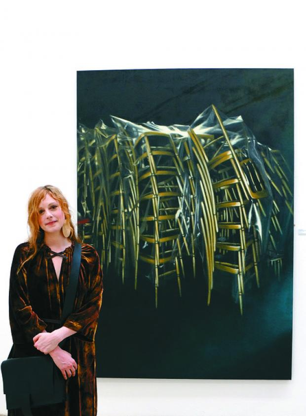 Lexi Strauss in front of Debutants, one of her Empty Chair series of paintings