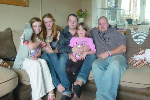 Natalie Williams (second from left) with sisters Rachel and Caitlin and mum and dad Catherine and Allan