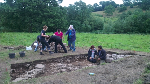 Volunteers and Herefordshire Council archaeology supervisor David Williams (in trench, right) investigate the foundations of a large medieval house near Bromyard.