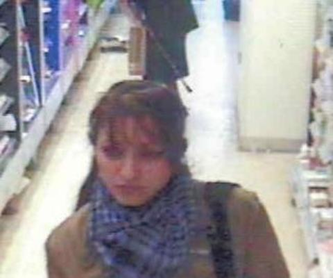 Police have released this CCTV image of a woman they believe may have vital information about who was responsible for taking cosmetics from a Ledbury store.