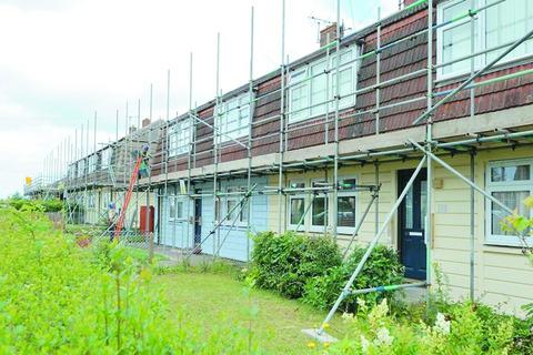 Before: These homes in Newtown Farm are being refurbished
