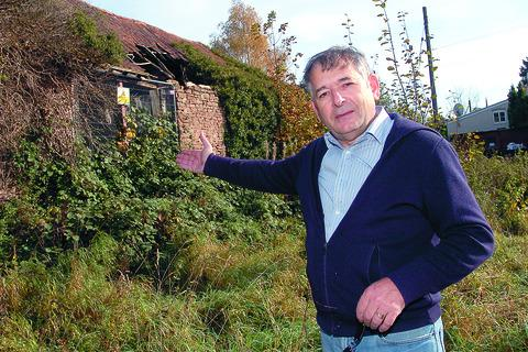 Carlos Felices next to the barn at the centre of the planning row. Picture by James Maggs.