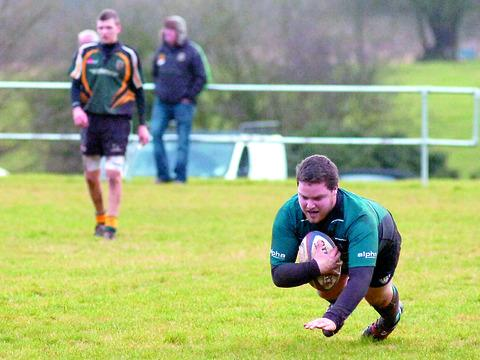 Andrew Wilkes goes over for one of his two tries for Tenbury.