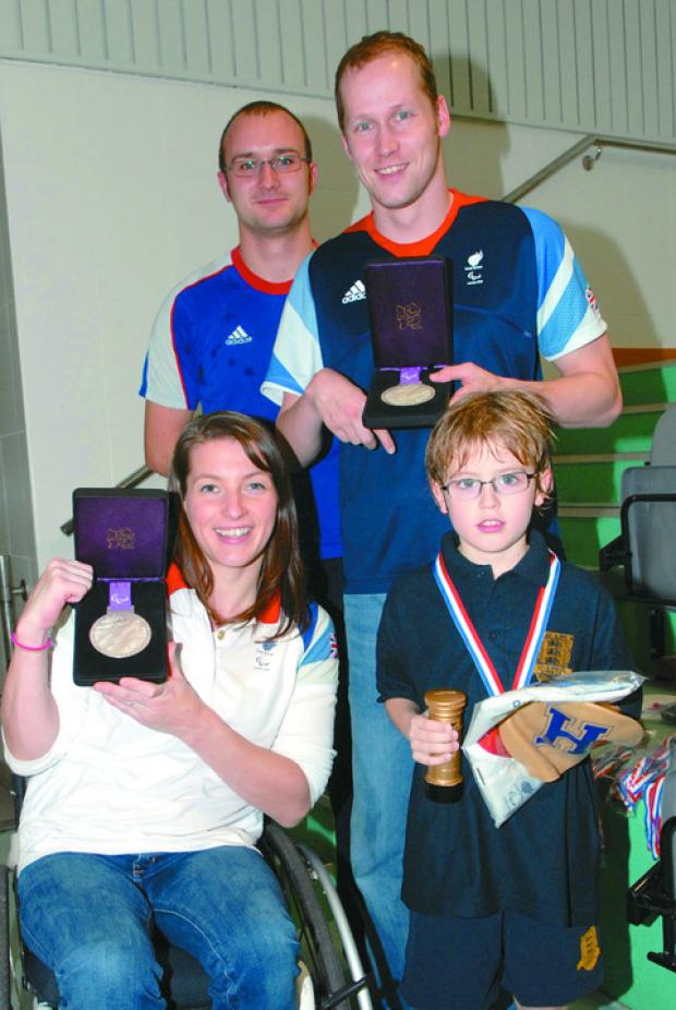 Max Bufton, who is     pictured with Hereford's Paralympic champions Nyree and Sascha Kindred and coach Alex Dallimore, raised £181 in sponsorship and received a gold medal and some London 2012 kit donated by Sascha and Nyree.
