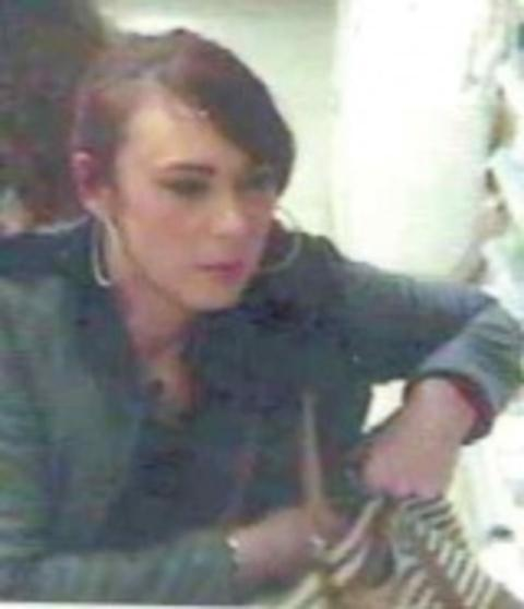 A CCTV image of a woman police wish to speak to in connection with the theft of cosmetics from a Ledbury store.