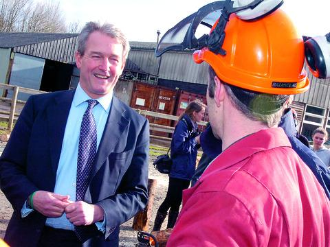 Environment Secretary Owen Paterson talks to forestry lecturer John Tetley in Holme Lacy.