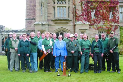 Gillian Ison and David Cochrane            (pictured in the centre)     are congratulated by the Hereford Archery Association.