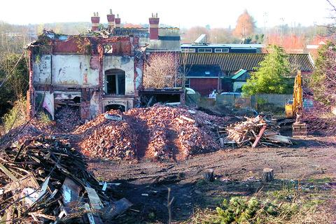 A bulldozer brings down part of the derelict Campions restaurant in Hereford.