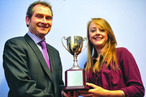Morgan Baynham Williams receives the Ted Woodriffe Trophy from Hereford Times deputy editor Andrew Doyle.